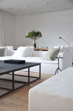 """Alex Rodriguez's home by Briggs Edward Solomon. Beach sofa by BES, fabric by De la Cuona, coffee table with honed negra marquina top by BES, german white oak dining table by Vincent Vanduyson, pendants by Luminaire, trepied side table from Christian Liaigre, dolphin floor lamp and 10"""" belgian white oak floors from Bois Chamois."""