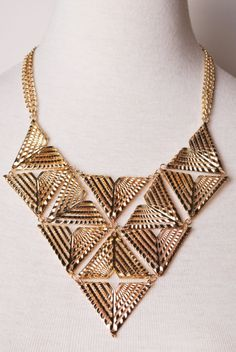 golden geometric statement necklace.