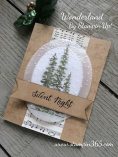 STAMPS: Wonderland. PAPER: Home for Christmas DSP, Kraft, Vellum, Whisper White. INK: Mossy Meadow, Versamark, Basic Black. OTHER: Banner Triple Punch, Big Shot, Ovals Collection, Softly Falling EF, Sponge.