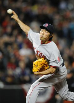 Boston Red Sox relief pitcher Koji Uehara, of Japan, delivers a pitch against the Baltimore Orioles during the ninth inning on 4-2-14.