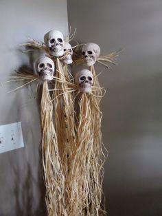 DIY tiki headhunter decoration- bamboo, raffia, foam skull