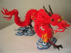 This origami dragon is made of 9000+ triangular folded pieces. Warning: very time consuming. From Papercraft Central.