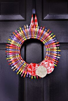 Hot glue scrap material around the wreath. Glue crayons to flat side of wreath.