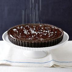"""Salted Chocolate Tart - """"We prefer Maldon sea salt for sprinkling onto this tart. Its large flakes look striking against the glossy chocolate surface, and its crunchy texture contrasts beautifully with the smooth, velvety filling."""""""