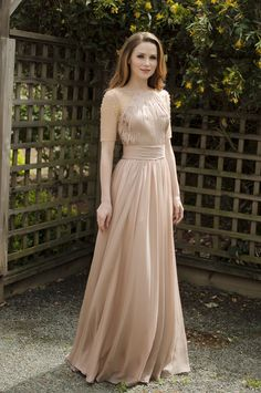 Tan floor length dress with an empire waist and sheer sleeves with pearl detailing. Love this elegant dress!