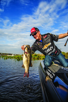 FLW and Typhoon pro angler, Jay Yelas with a trophy winning bass. Jay likes to sight fish with the Typhoon Mariner with the sunset brown AquaView® hydrophobic polarized lens.