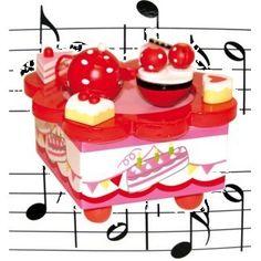 """Muziekdoos cups and cakes , Een jolige theepot danst met guitige kop en schotels op muziek van """"la vie en rose""""."""