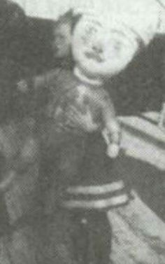 "A very blurry photo of the Grand Duchess Anastasia Nikolaevna Romanova of Russia carrying an effigy. ""AL"""