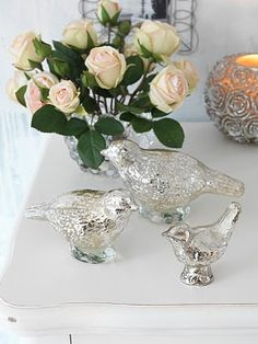 Antiqued glass birds: A set of three gorgeous antiqued silver glass birds to adorn your home.