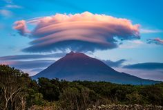 """Sunset on Mount Pico, the highest peak in Portugal (2351 metres). Located on Pico Island in the Azores, this stratovolcano is dormant and last erupted in 1718. His famous hat (a lenticular cloud) looked actually more like a turban when I captured this shot. - Visit my website <a href=""""http://www.enricophoto.com/"""">www.enricophoto.com</a> - <a href=""""http://www.enricophoto.com/Behind-the-Shots/Pico-Turban"""" title..."""
