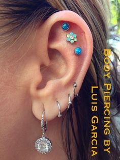 4 month old triple helix done at radiating angles with Anatometal 4mm blue opals and large white opal/CZ flower cluster.