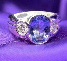 Menashe & Sons Jewelers custom semi bezel tanzinite ring