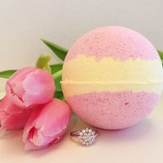 Pearl Bath Bombs Spring Tulips Ring Bath Bomb Put some long awaited spring in your step with our new Spring Tulips bath bomb!! Start your new spring beginnings with this delicately floral scent, bound to have you convinced you're frolicking free through magical meadows!! Make Spring Tulips your go-to for a splash of springtime bath time fun.