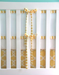 breathable mesh bumper with piping and ties in any fabric, bumperless crib bedding. $120.00, via Etsy.