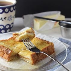 Hong Kong Style French Toast - what's not to love about a PB sandwich dipped in eggs and pan-fried then drizzled with maple syrup? This is wonderful.... I used to love these as a kid! They were available at every good Cantonese style cafe :)