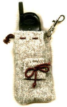 I have an old sweater with some holes in it, I am going to try and repurpose it into this phone cozy