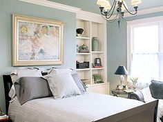 love the soft blue walls with dark bed
