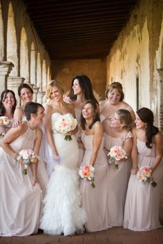 love the color of the bridesmaids dresses and how they are all slightly different