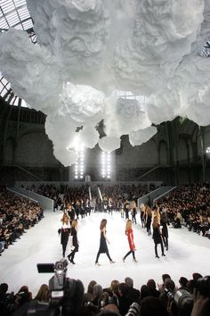 CHANEL Fall/Winter 2007. Square catwalk with a suspended skyscape of tulle clouds.