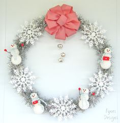 You could keep this wreath up even after the holidays are over! Made with sparkly garland, dollar store snowflakes, and styrofoam balls on a BBQ skewer- easy to make