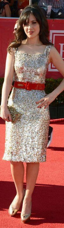 Zooey Deschanel in Oscar de la Renta, Sergio Rossi shoes, Edie Parker purse, and jewelry by Dana Rebecca