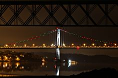 """The Mid-Hudson Bridge spanning the mighty Hudson River is lit up for Christmas (with the """"Walkway over the Hudson"""" silhouette in the foreground), and the City of Poughkeepsie waterfront in the background. -- December 8, 2012."""