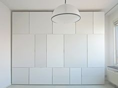 white built-in storage with varying sizes of storage compartments