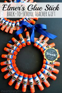 Stock up on back to school supplies and create this cute Elmer's Glue Stick Wreath for a Back-to-School Teacher Gift.