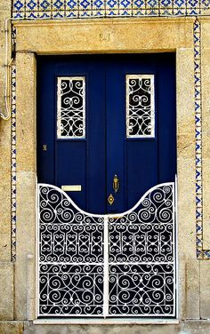 Blue door with fancy white railings
