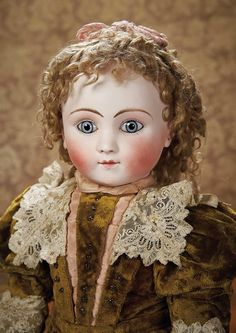 As in a Looking Glass: 48 Extremely Rare French Bisque Bebe,Series B,by Jules Steiner with Superb Costume