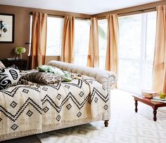 The Best It-Girl Bedrooms// mixed prints, peach drapery, Chesterfield bed