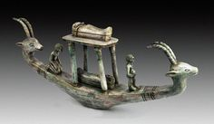 Miniature Funerary BoatAncient Egypt - 18th Dynasty Green glazed limestone boat, with horned animal heads in the front and the back of the b...[solar barque and the firmament house of the sun]