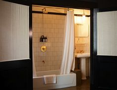 Masculine bathroom in the Ace Hotel by Roman & Williams.