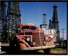 """Ansel Adams is best known as the master of black and white landscape photography, but this Kodachrome color photo is a rare exception. It depicts a worker surveying a Los Angeles-area Shell oil field. Adams took this photo for the 1945 """"Pacific Coast"""" issue of Fortune, which featured the work of artists and photographers native to the West Coast."""