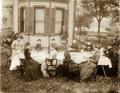 Mrs. Emil Boehl and friends having coffee in back yard. Circa 1875-1885.