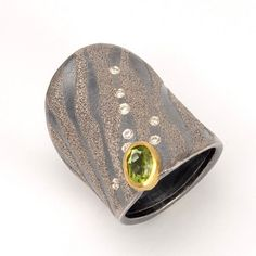 "Ring, Oxidized Silver, 22k Gold and Platinum with .91 ctw Peridot and .08 ctw Champagne Diamonds, 1.18"" long"