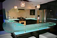 Glass countertop - we have installed several of these in game rooms & bar areas - really cool stuff