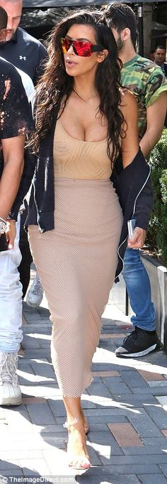 So glam: Kim rocked her beachy waved locks and reflective shades as she strolled…