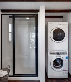 bathroom laundry Mint Tiny House Company has recently released its attractive () and () tiny house on wheels editions, with an attractive price to match. Laundry Bathroom Combo, Tiny House Bathroom, Laundry Room Design, Small Bathroom, Tiny House Shower, Modern Bathrooms, Bathroom Ideas, Tiny Houses For Rent, Modern Tiny House