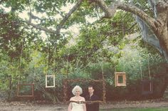 Get the whole wedding party to each stand in front of a frame. Use simple clean frames (white and rose)... these are too rustic