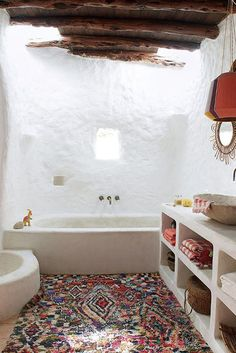 One of the simplest and most impactful ways to elevate your shower or tub-side styling is by swapping in a beautiful rug in place of a bath mat.