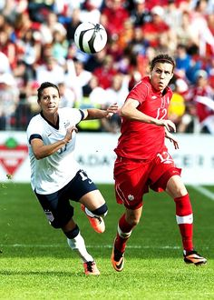 More of this coming soon - Ali Krieger and Christine Sinclair (Aaron Vincent Elkaim/The Canadian Press)