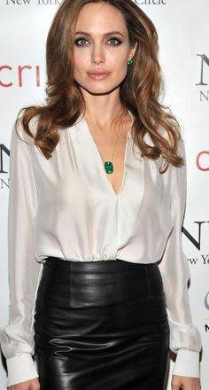 Emerald accessories, leather skirt, silk blouse