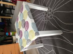 Ikea Lack table hack. Used a duvet cover and attached it to the table top with Mod Podge and coated in polyurethane.