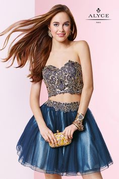 Fashion forward and dazzling from any angle! Stand out in this adorable two-piece short dress showcasing a beautiful beaded lace applique bandeau style crop top with Beaded embroidered lace and tulle skirt to matc Alyce Paris Homecoming