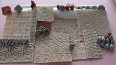 This is a collection of stamps made with smaller carved or sculpted stamps. polymer clay