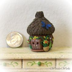 Dark Brown Acorn Cap Faerie Hut is a detailed large but still tiny sculpted dollhouse scale Faerie house with the sweetest little blue butterfly accenting the top. Fimo Clay, Polymer Clay Projects, Polymer Clay Creations, Polymer Clay Art, Acorn House, Clay Figures, Blue Butterfly, Faeries, Dollhouse Miniatures