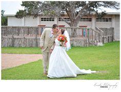 Burnt Orange wedding near Austin, Texas with longhorn at wedding venue; Twisted Ranch Wedding Photographer
