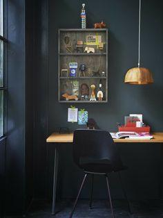 Narrow bookshelf above the desk