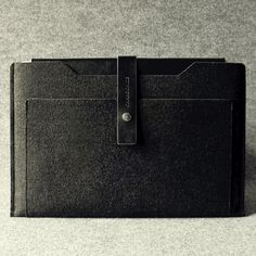Leather Macbook Air sleeve made of black vegetable tanned leather and grey recycled wool felt. Wool does not pill and is water resistant. Please allow 2-3 weeks for shipping.